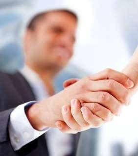 Business man closing a deal with a handshake_818-TUMB