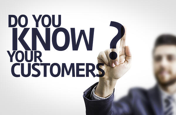 Business man pointing to transparent board with text Do you Know your Customers?
